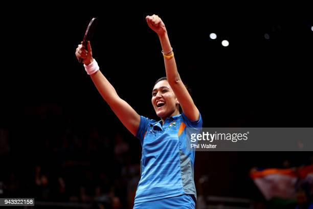 Manika Batra of India celebrates her win over Yihan Zhou of SIngapore to win the gold medal in their Womens Team gold medal match during Table Tennis...