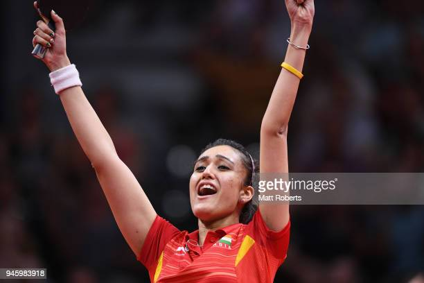 Manika Batra of India celebrates winning the Women's Singles semi-final Table Tennis match against Tianwei Feng of Singapore on day 10 of the Gold...