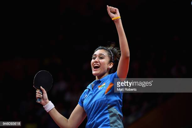 Manika Batra of IndiaÊcelebrates defeating Mengyu Yu of Singapore during the Women's Singles Gold Medal Table Tennis match on day 10 of the Gold...