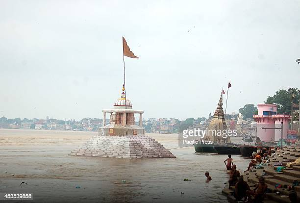 Manikarnika Ghat and other temples submerged in water from the overflow of the Ganga river caused by heavy rains.
