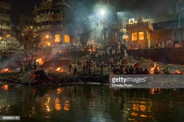 manikarnika ghat at varanasi, uttar pradesh, india, asia - manikarnika ghat stock pictures, royalty-free photos & images