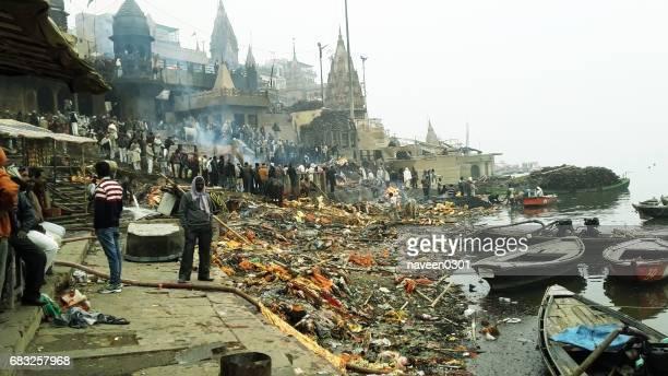 manikarnika ghat - hindu funeral cremation place at varanasi, india - river ganges stock pictures, royalty-free photos & images