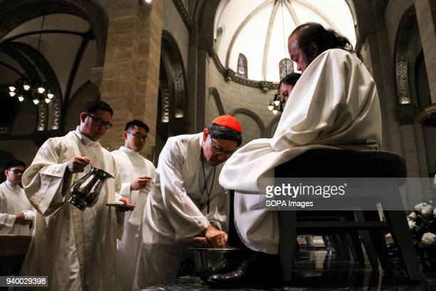 Manila Archbishop Antonio Cardinal Tagle washes the foot of Fr Teresito ìChitoî Suganob Fr Suganob was abducted by ISIS aligned groups during the...