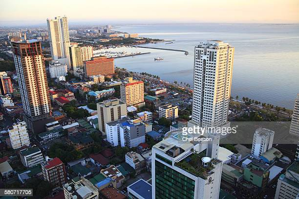 manila bay high rises - manila bay stock photos and pictures