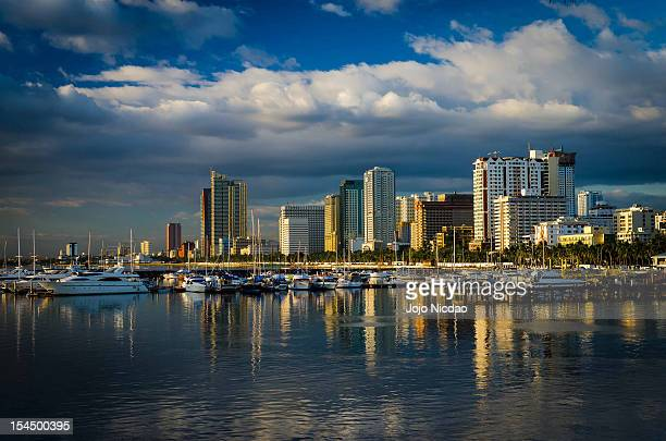 manila bay in philippines - manila bay stock photos and pictures