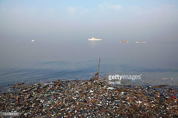 manila bay pollution. - manila bay stock photos and pictures