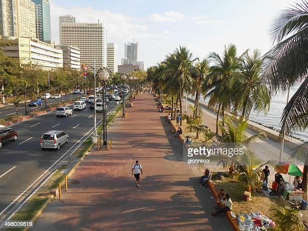 manila baywalk, philippines - manila bay stock photos and pictures