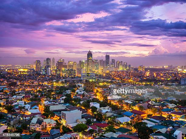 manila city at twilight showing bonafacio global city, ortigas - manila philippines stock pictures, royalty-free photos & images