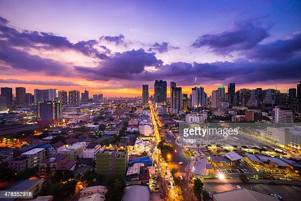 manila city at twilight showing makati city and ortigas - manila philippines stock pictures, royalty-free photos & images