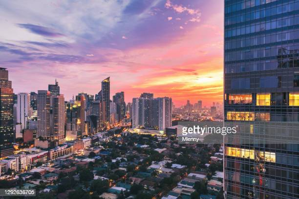 manila colorful sunset makati skyscrapers metro manila philippines - capital region stock pictures, royalty-free photos & images