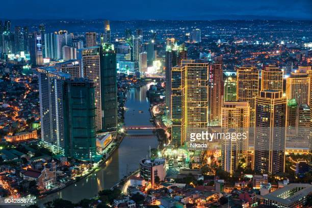 manila makati at twilight - manila philippines stock pictures, royalty-free photos & images