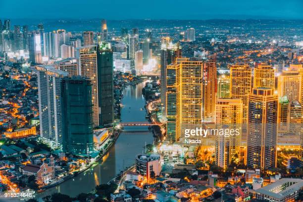 manila makati at twilight - makati stock photos and pictures