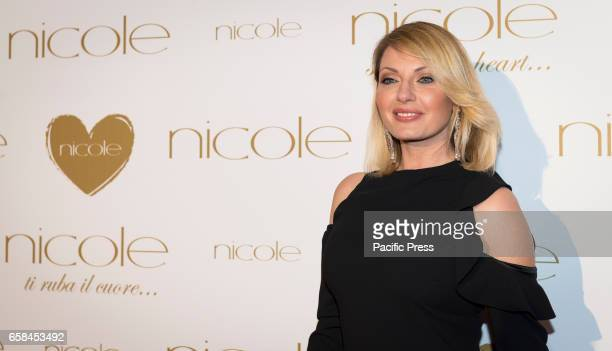 Manila Nazzaro attends the photocall of 'Nicole Fashion Show'