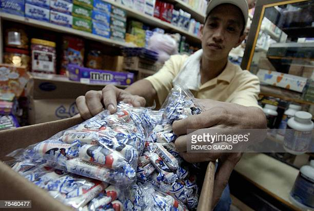 A store personnel shows a box of the popular 'White Rabbit' candy brand from China pulled out from the shelf in at a Manila store 18 July 2007 after...