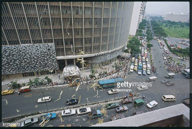 """Manila, Philippines: Aerial view of an anti-government """"Noise Barrage"""" in the Makati Business district of Manila."""