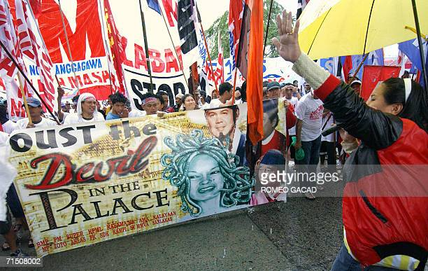Antigovernment demonstrators display a portrait depicting President Gloria Arroyo as a devil as they demand her ouster during a rally near the...