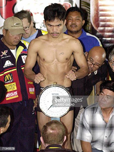 """Filipino boxer, former WBC flyweight champion and ex-IBF junior featherweight champion Manny """"Pac Man"""" Pacquiao weighs in at 129.5 pounds in Manila,..."""