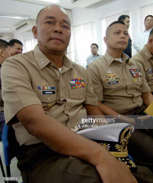 Former Marine commandant Major General Renato Miranda and Marine Colonel Ariel Querubin attend proceedings at the justice department in Manila 20...
