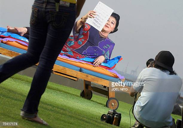 Former Philippines first lady Imelda Marcos takes part in a photo shoot beside the bayside pool of a top hotel in Manila 06 November 2006 for the...