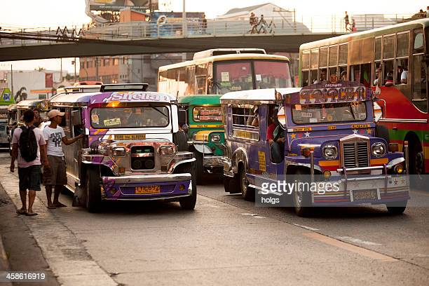manila, philippines - jeepney traffic - jeepney stock pictures, royalty-free photos & images