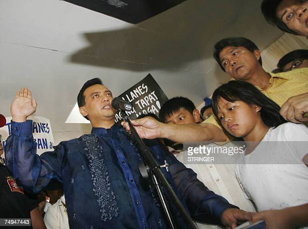 Opposition candidate and now a newlyelected Senator Lt Senior Grade Antonio Trillanes takes his oath of office in his hometown of Caloocan city north...