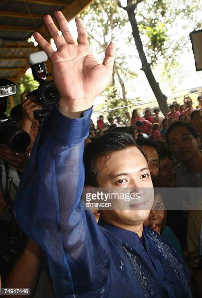 Opposition candidate and now a newlyelected Senator Lt Senior Grade Antonio Trillanes waves to supporters before taking his oath of office in his...
