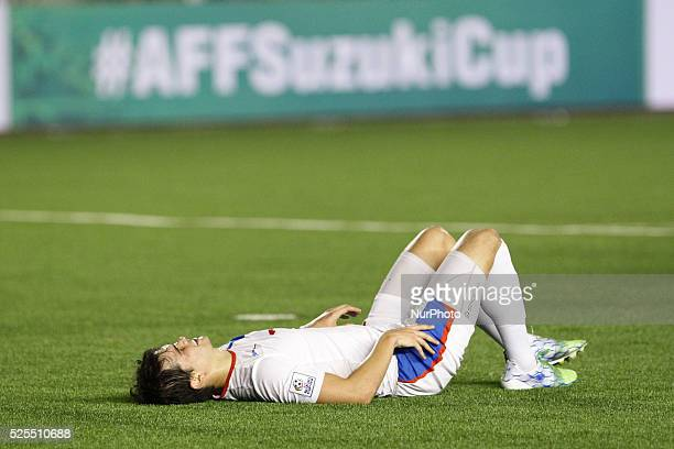 Manila Philippines Phil Younghusband of the Philippines lies on the field after missing an attempt on Thailand's goal on the first leg of the AFF...