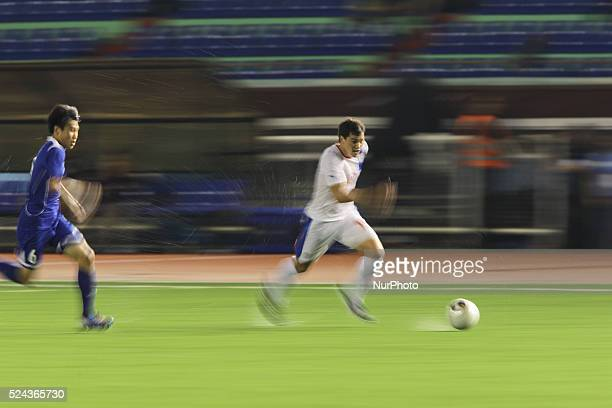 Manila Philippines Phil Younghusband of the Philippines runs past Wu ChunChing of ChineseTaipei at the Rizal Memorial Stadium on September 3 2014 of...
