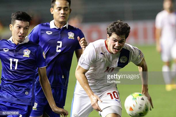 Manila Philippines Phil Younghusband of the Philippines vies for the ball against a Thailand's Tanaboon Kesarat on the first leg of the AFF...