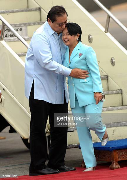 Philippine President GLoria Arroyo is met by her husband Jose Miguel Arroyo as she arrives home in Manila 11 May 2006 after a fourday state visit to...