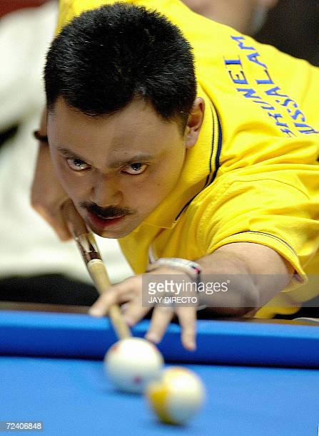 Prince Muhtadee Billah of Brunei sets up a shot during a preliminary round match against Darren Appleton of England during the World Pool...