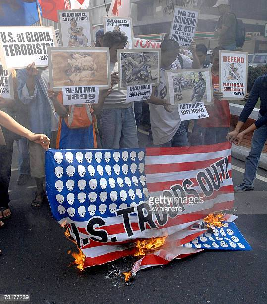Protesters burn a mock US flag near the US embassy in Manila 02 February 2007 demonstrating against 108th anniversary of the FilipinoAmerican war...