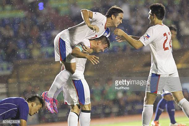 Manila Philippines Rob Gier of the Philippines is hugged by teammate James Younghusband after scoring the first goal against ChineseTaipei at the...