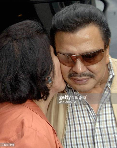 Senator Luisa Ejercito wife of deposed president Joseph Estrada kisses her husband goodbye as he prepares to leave the latest hearing of the...