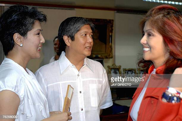 The son and daughters of the late dictator president Ferdinand Marcos Irene Ferdinand Bong Bong Jr and Imee during the launching of the books and...