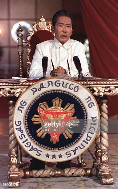 TO GO WITH 'PHILIPPINESMARCOSANNIVERSARY' This file photo dated 24 February 1986 shows Philippines President Ferdinand Marcos holding a press...