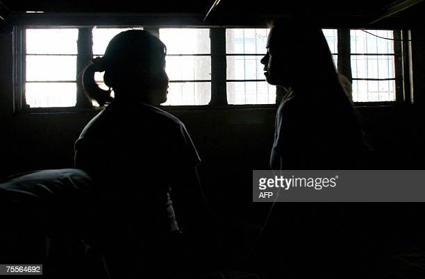 TO GO WITH PHILIPPINESTRAFFICKING by Jason Gutierrez Geralyn Quezo looks on as she stands by a fellow victim of human trafficking at the Visayan...
