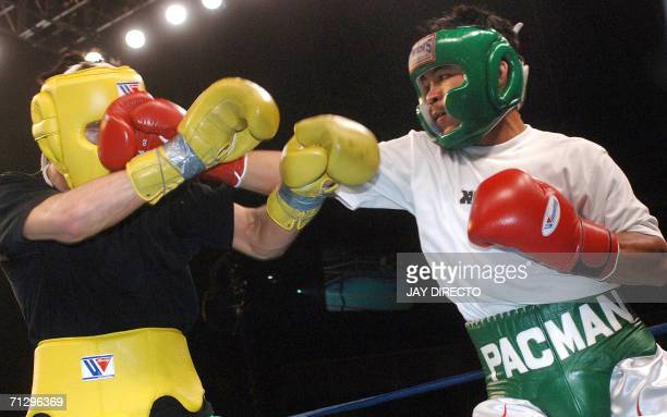 Top Filipino boxer former WBC flyweight champion and exIBF junior featherweight champion Manny Pacquiao spars with Russian Rustam Nugaev during a...