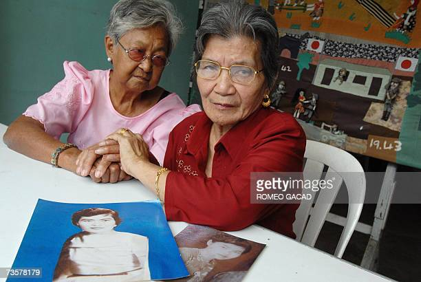 Two Filipina comfort women Simeona Ramil and Virginia Villarma sits with portraits of Virginia in her younger years while behind is a quilt depicting...