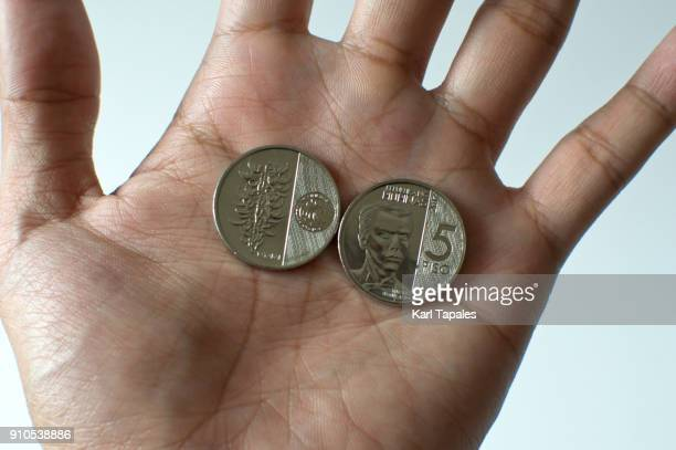Manila, Philippines 'u2013 January 2018: A newly issued five peso coins of Banko Sentral ng Pilipinas