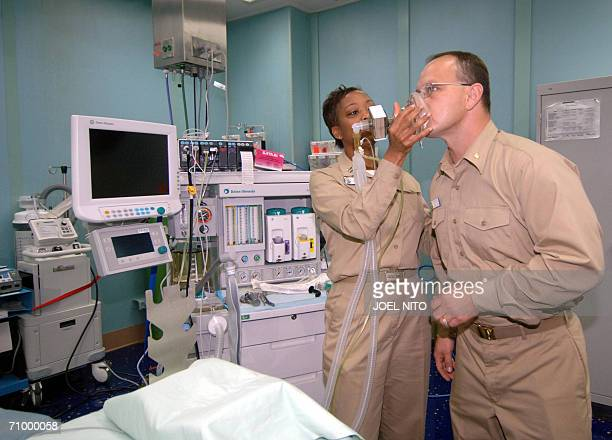 US navy nurses shows medical equipment during a media tour of the USNS Mercy hospital ship which is anchored in Manila Bay 21 May 2006 The US...