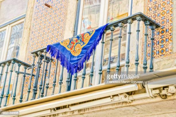 Manila Shawl in a balcony in Rua da Prata, Lisbon, Portugal