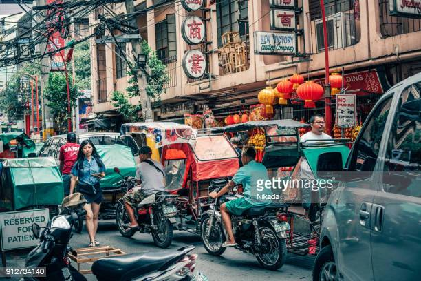 manila street scene in chinatown - manila stock photos and pictures