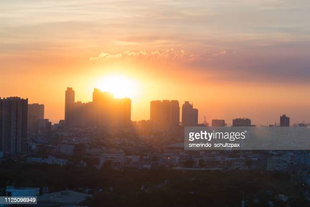 manila sunset - makati stock photos and pictures
