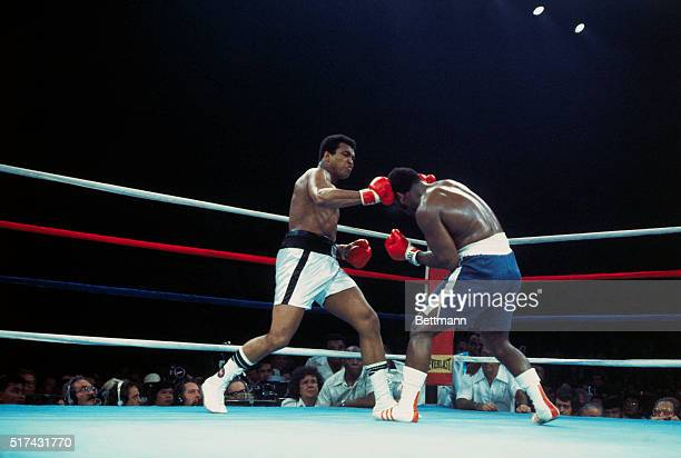 Manila, The Philippines: Champion Muhammad Ali lands a right on Joe Frazier's head during the 2nd round. Ali held his title 10/1 defeating Frazier by...