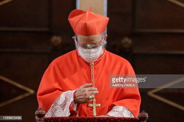 Manila's new Archbishop Cardinal Jose Fuerte Advincula makes the sign of the cross during his installation ceremonies in Manila on June 24, 2021...