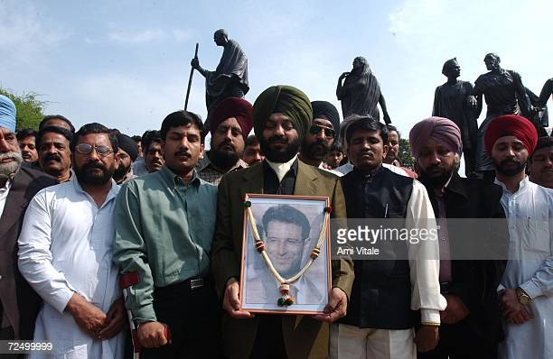 Maninder Singh Bitta chairman of the All India Terrorist Front holds a framed photograph of slain American Wall Street Journal reporter Daniel Pearl...