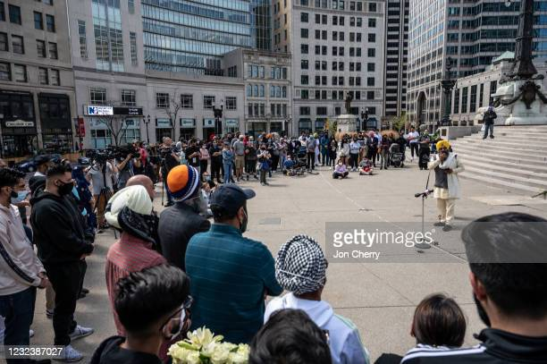 Maninder Singh Walia, a leader of the Sikh coalition of the Sikh Satsang of Indianapolis, speaks during a vigil at Monument Circle for the victims of...