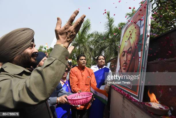 Maninderjeet Singh Bitta Chairman of the AllIndia AntiTerrorist Front with volunteers scouts guides pays tribute to Shaheed Bhagat Singh on the eve...