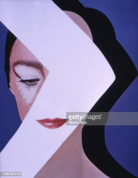Manipulated image of an unidentified model in makeup and with crystals on her face which is partially obscured by the silhouette of an arm October...